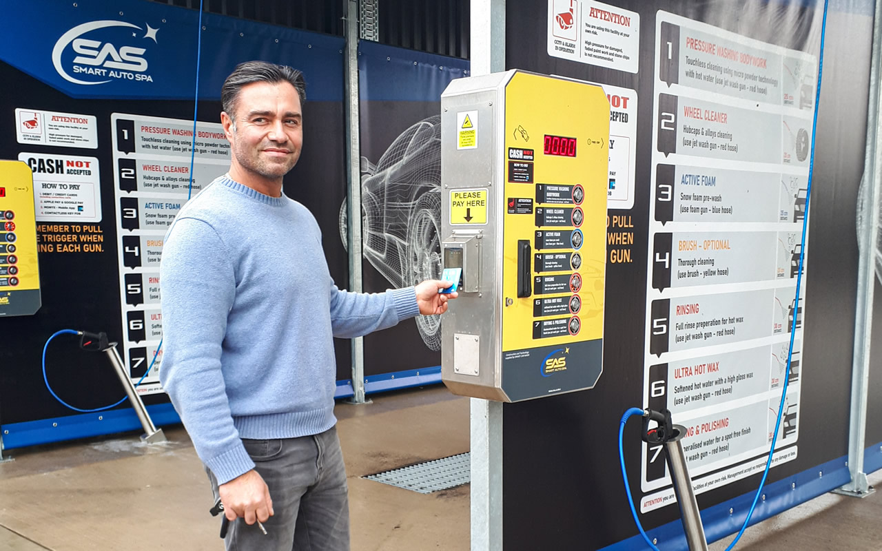Roberto at the pay point of his new state-of-the-art auto car wash in Wincanton