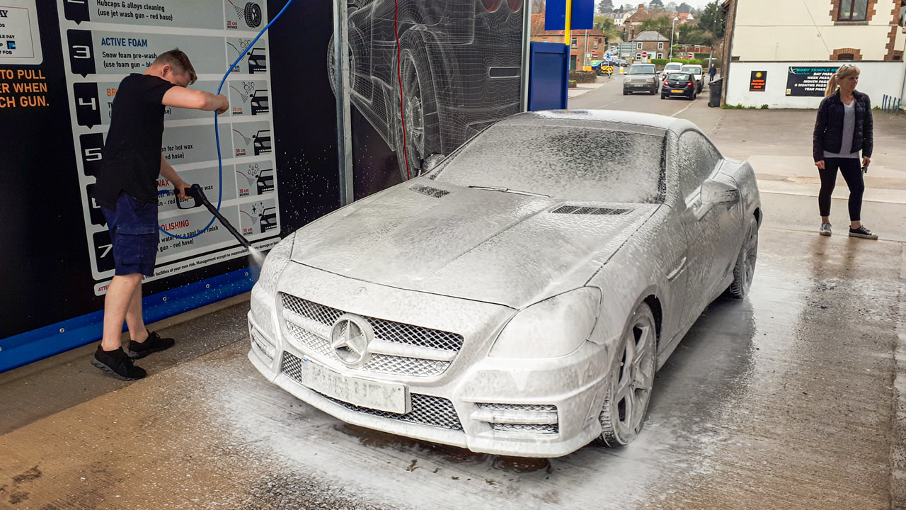 A customer using Roberto's brand new state-of-the-art auto car wash in Wincanton